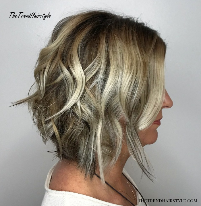 Tousled Blonde Highlights 20 Flattering Medium Length Haircuts For Women Over 50 The Trending Hairstyle