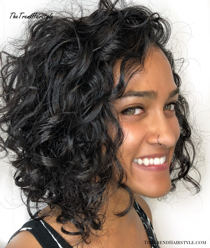 Black Curly Tousled Angled Bob Hairstyle