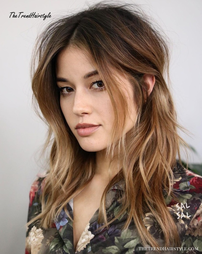 Centre-Parted Tousled Layered Hairstyle