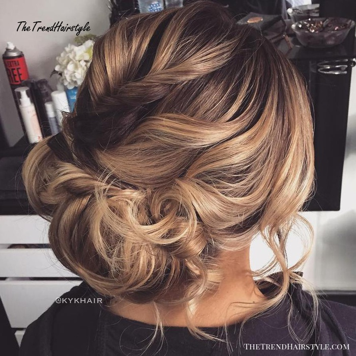 Curly Low Asymmetrical Updo