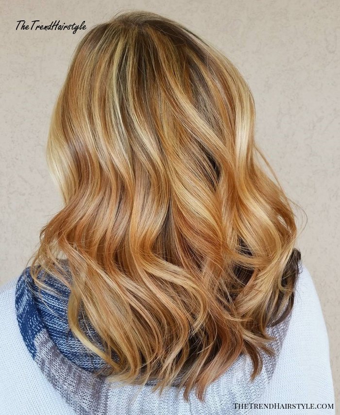Golden Blonde And Red Highlights