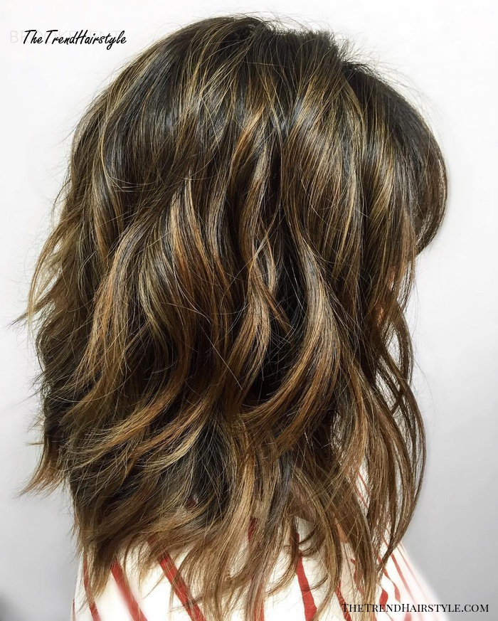 Layered Brunette Hairstyle With Golden Highlights
