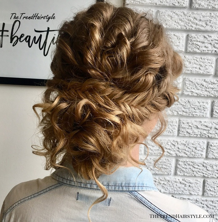 Low Messy Curly Bun with a Braid