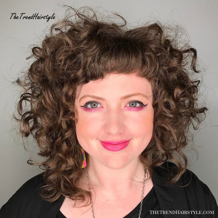 Medium Curly Hairstyle With Short Bangs