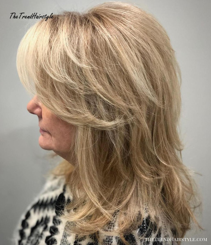 Medium Feathered Haircut For Women Over 50