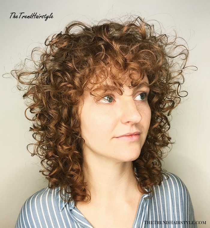 natural curls with curtain bangs and highlights  20