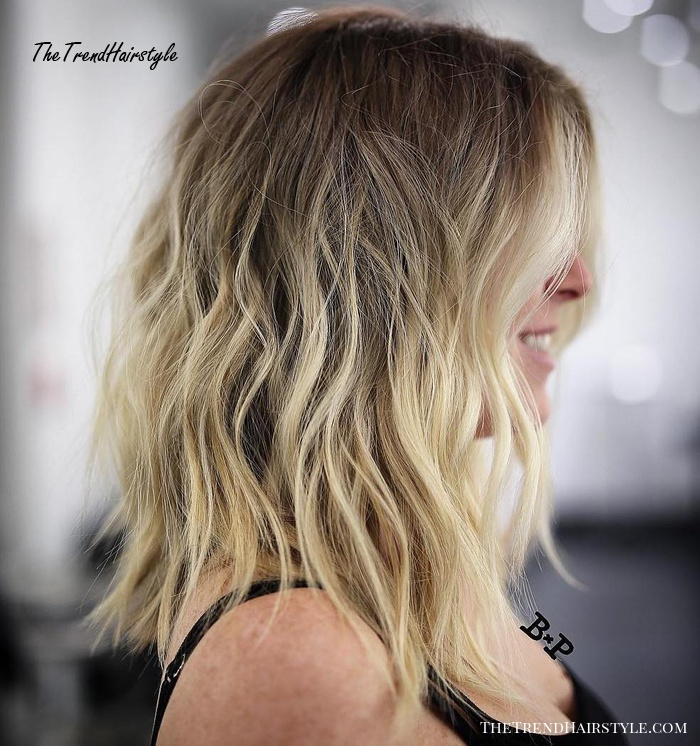 Medium Shaggy Blonde Balayage Hairstyle