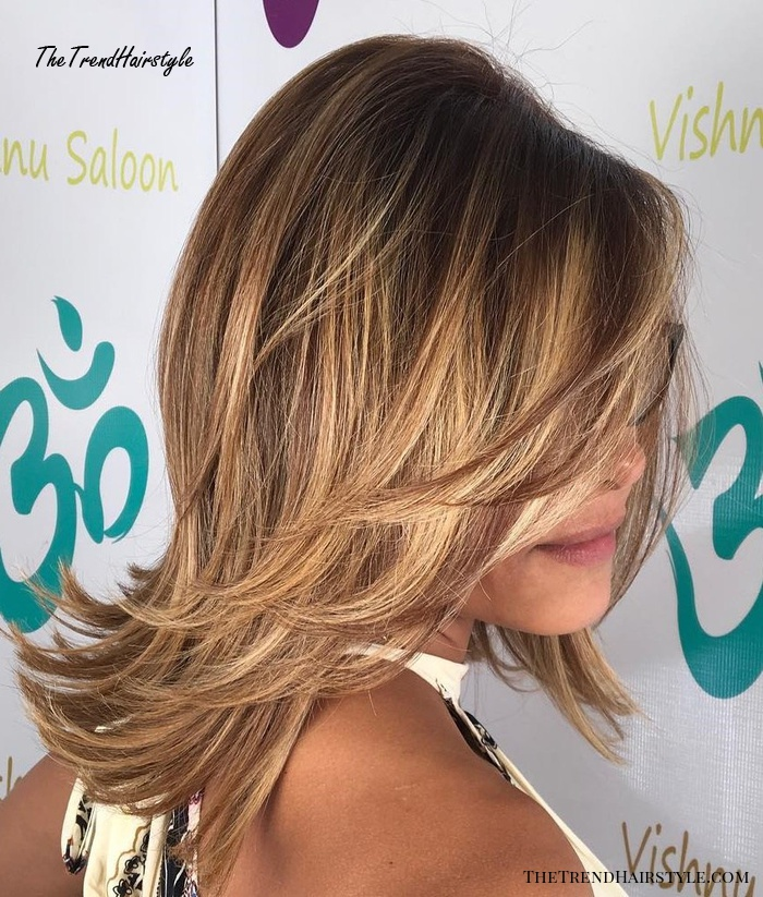Mid-Length Layered Hairstyle With Flicks