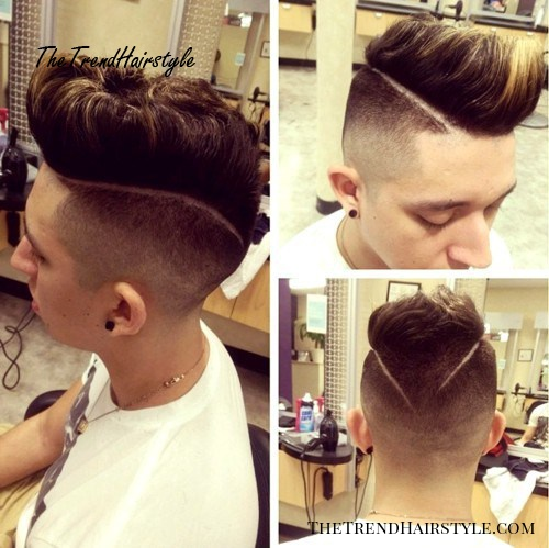 Mohawk with faded undercuts and shaven lines