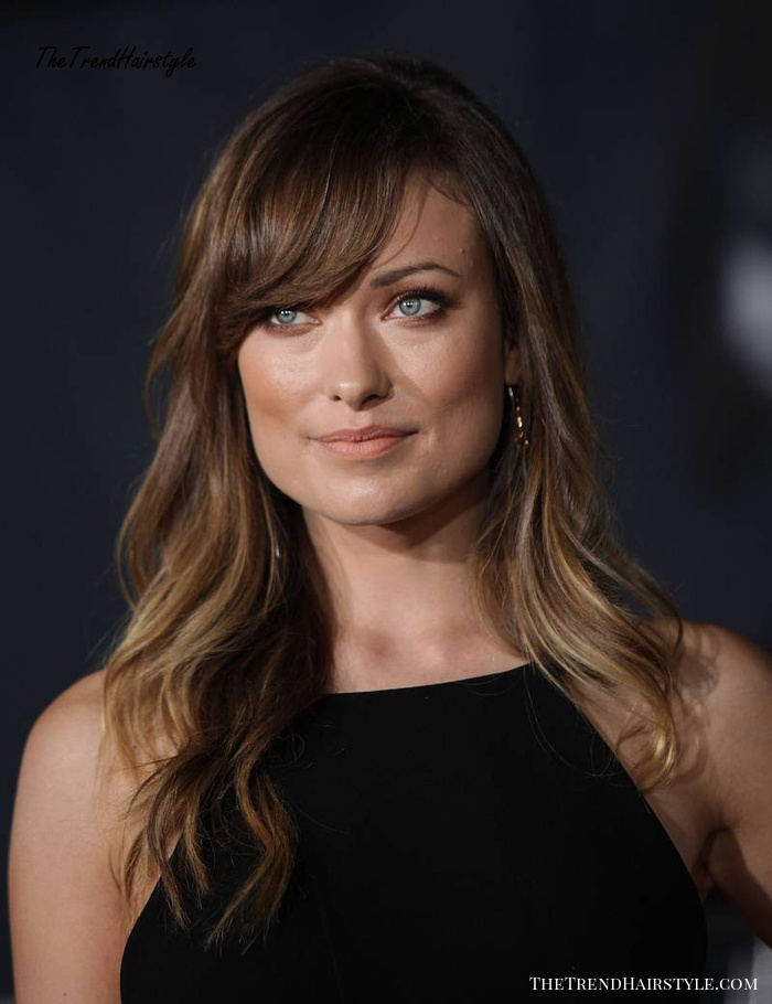 Olivia Wilde medium hairstyle with bangs for square faces
