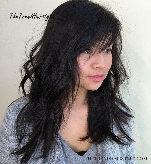 Tousled Hairstyle With Side Bangs