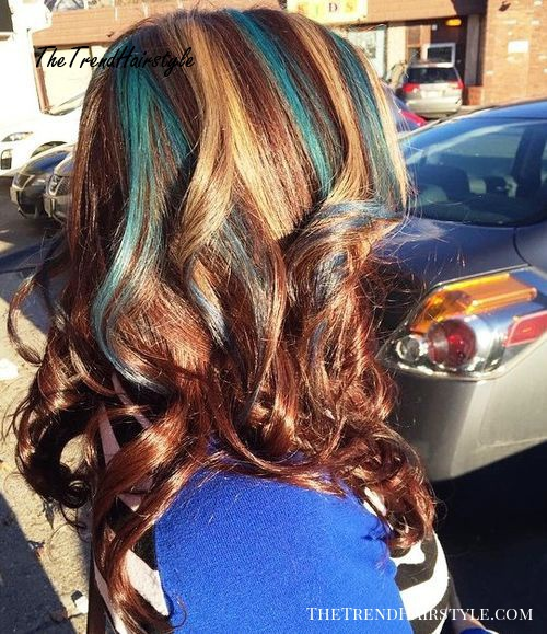 auburn hair with golden blonde and teal highlights