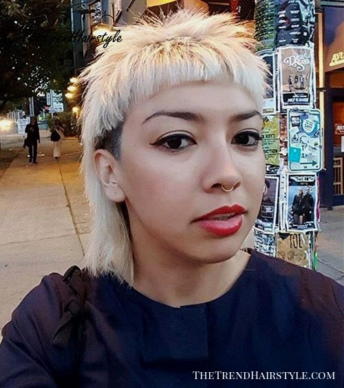 black and blonde mullet with cropped bangs