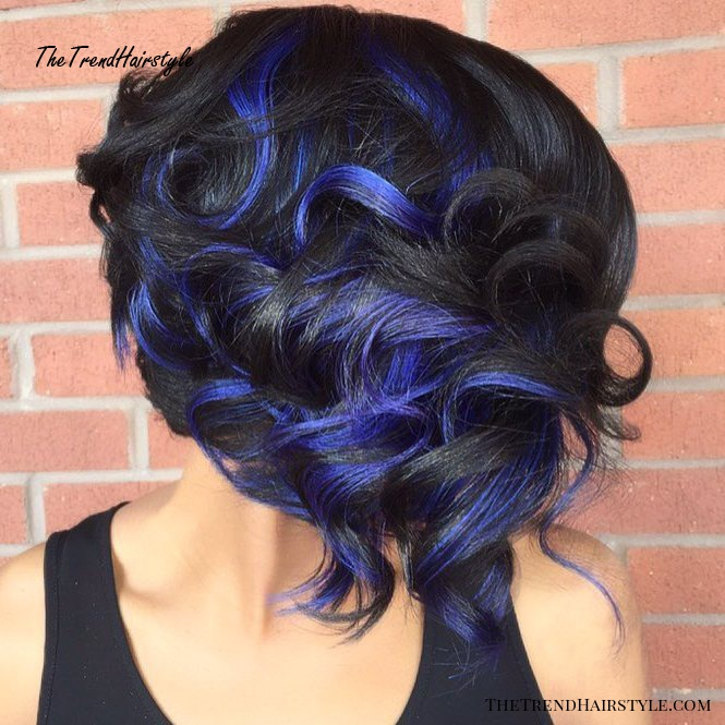black curly hairstyle with blue highlights
