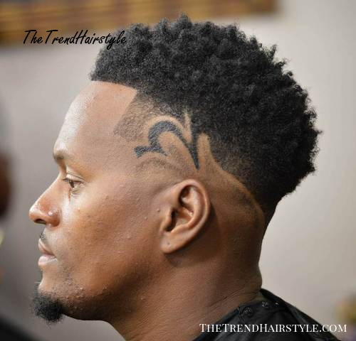 black men's curly haircut with design