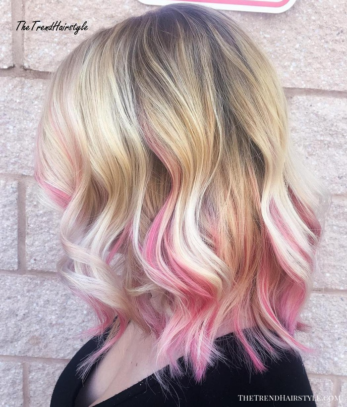 blonde lob with pastel pink highlights