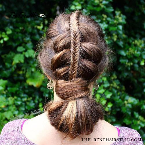 braided updo with a looped ponytail