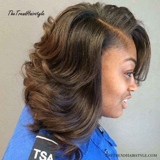 brown layered sew in hairstyle