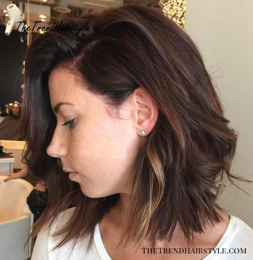 brown shaggy bob with subtle highlights