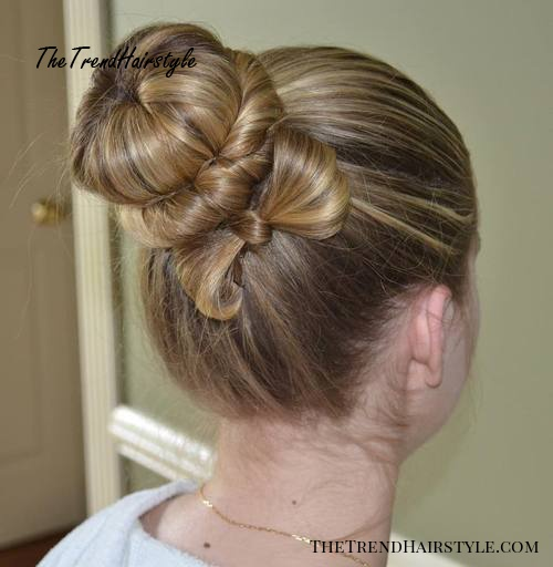 bun with a twist and bow