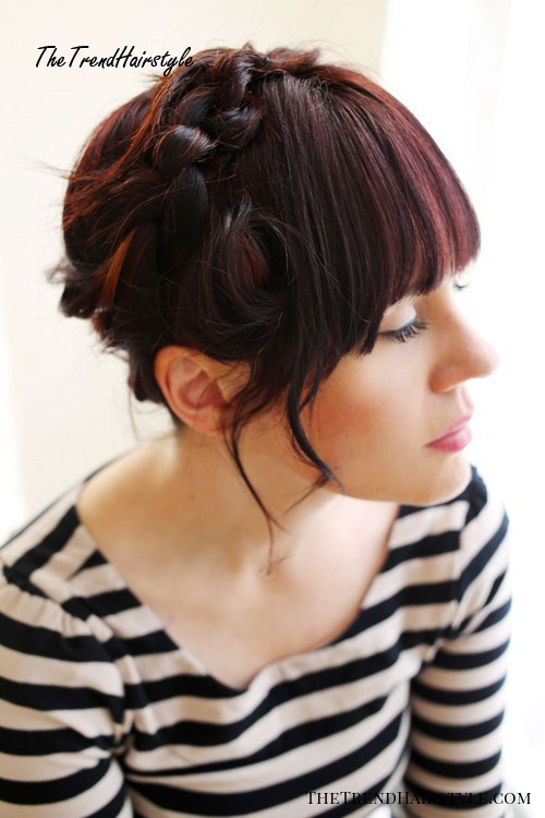 casual updo with knotted braid and bangs