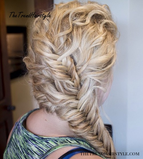 curly blonde hairstyle with two fishtails