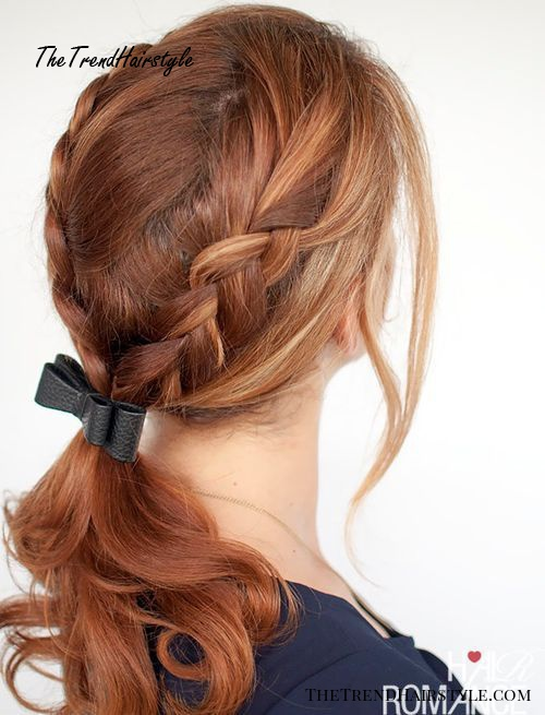 curly low ponytail with two side braids