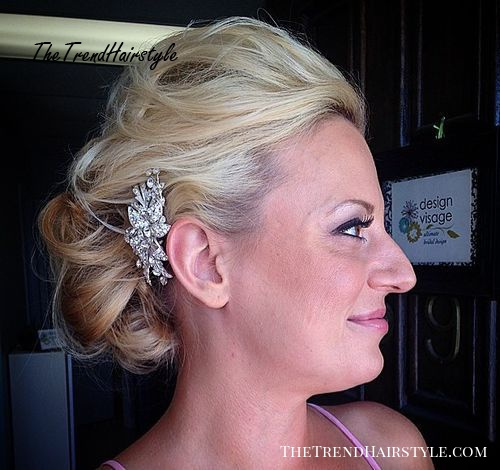 curly messy bridal updo for thin hair