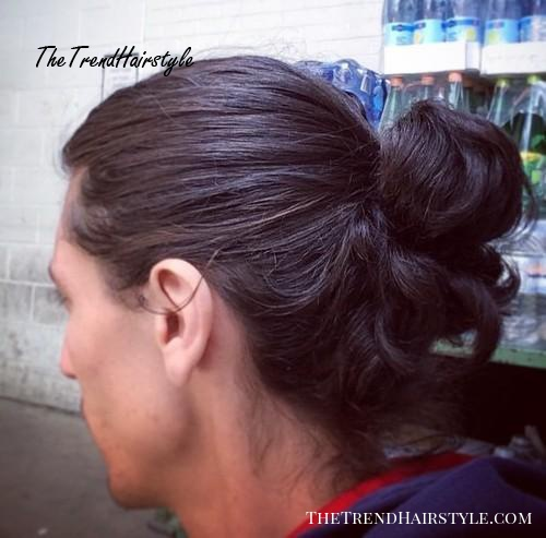 curly pony hairstyle for men
