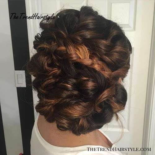 curly updo with a braid for thick hair