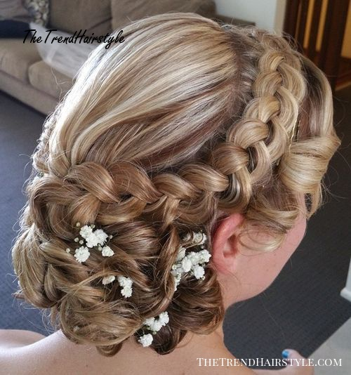 curly wedding updo with a dutch braid for long hair