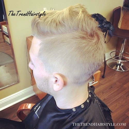 disheveled long top short sides hairstyle