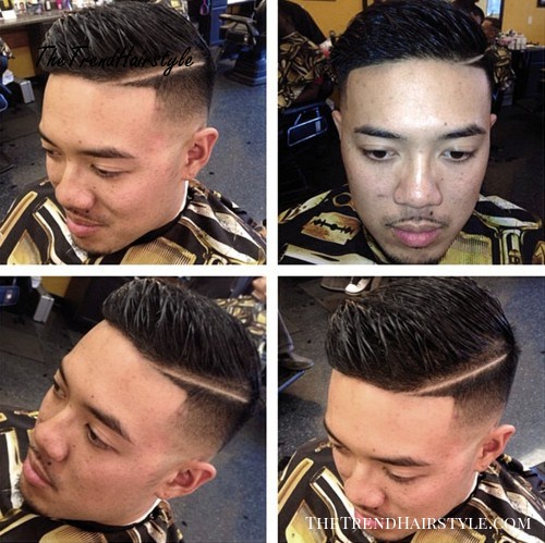 fade haircut with a shaved side part