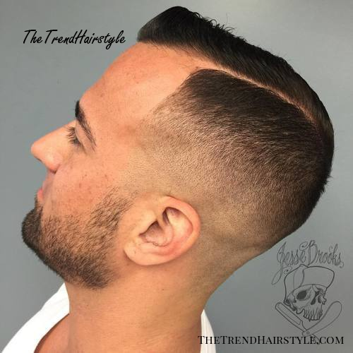 fade haircut with a side part