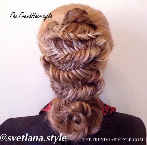 fancy fishtail hairstyle with braided flower