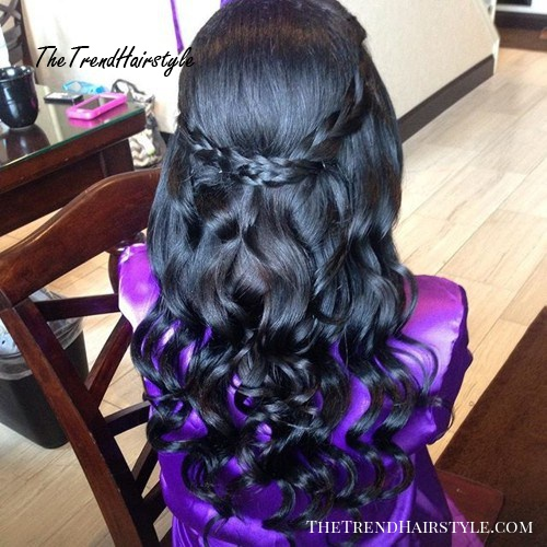 formal curly half up half down hairstyle with braids