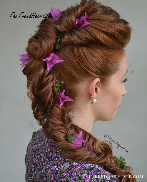 formal fishtail hairstyle with hair flowers