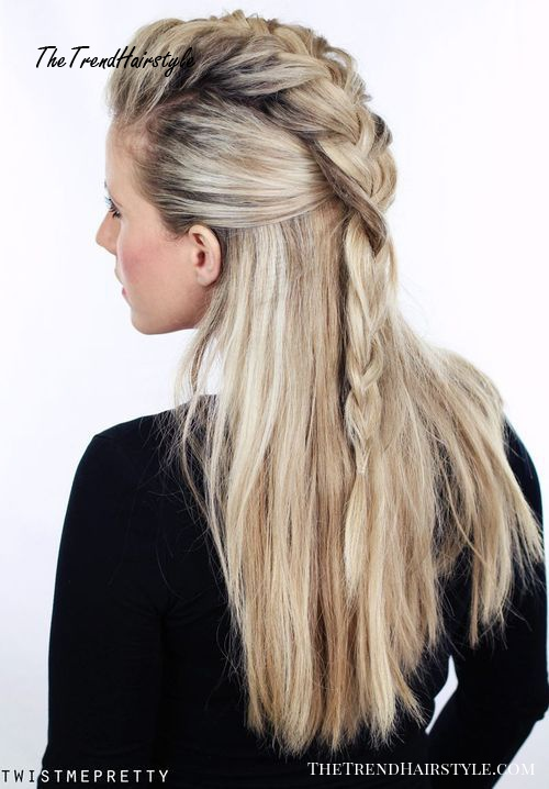 half up braided hairstyle with a fauxhawk braid
