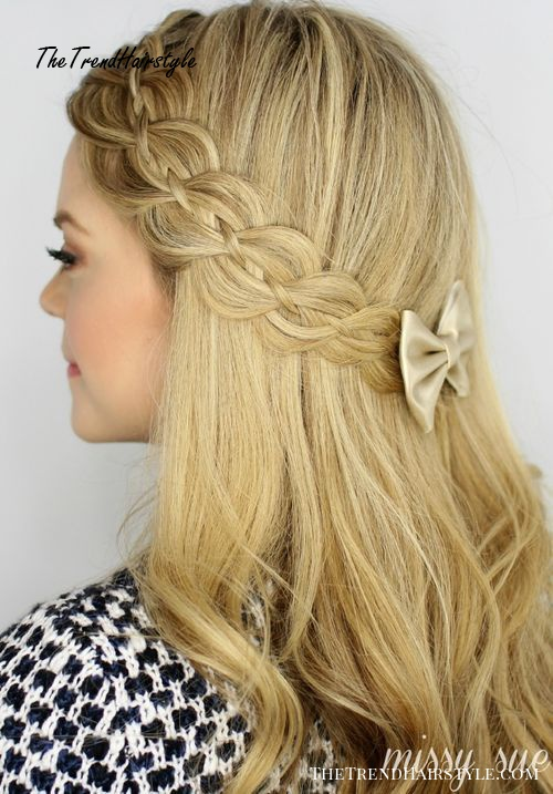 half up braided hairstyle with lacy braid