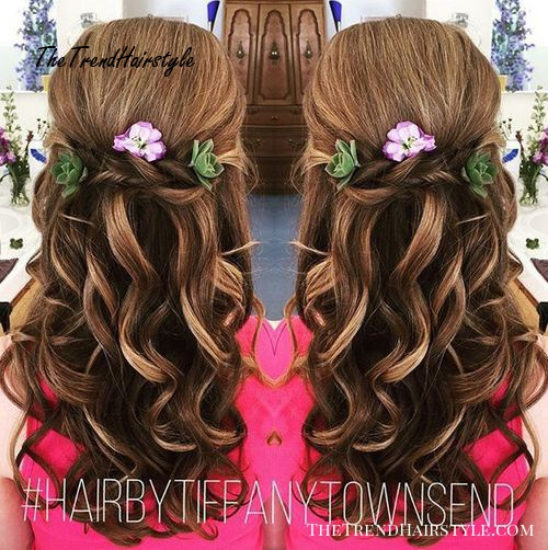 half up curly hairstyle with flowers