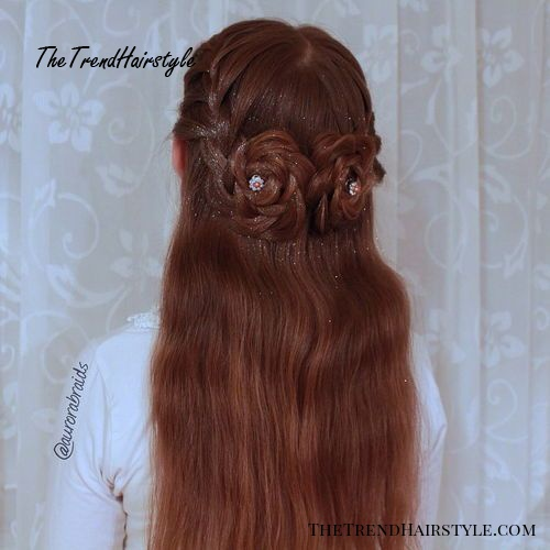 half updo with braided flowers for long hair