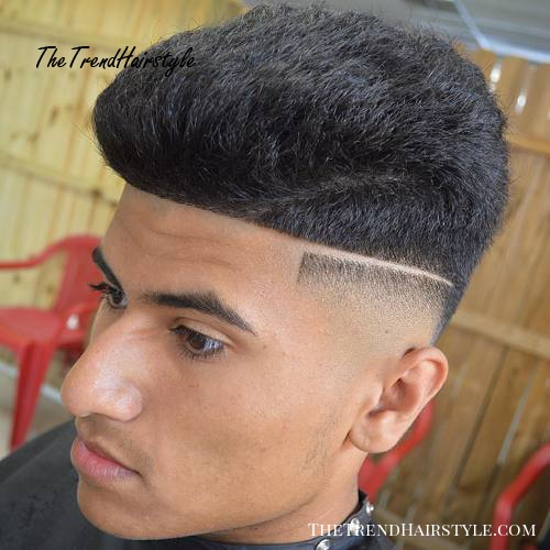 high top haircut with fade and shaved part
