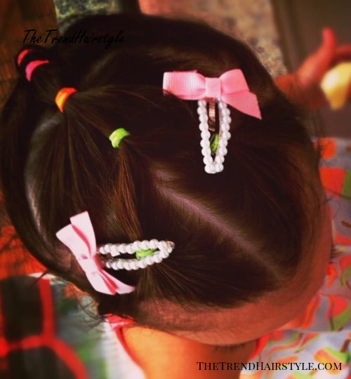 little girl hairstyle with colorful elastics