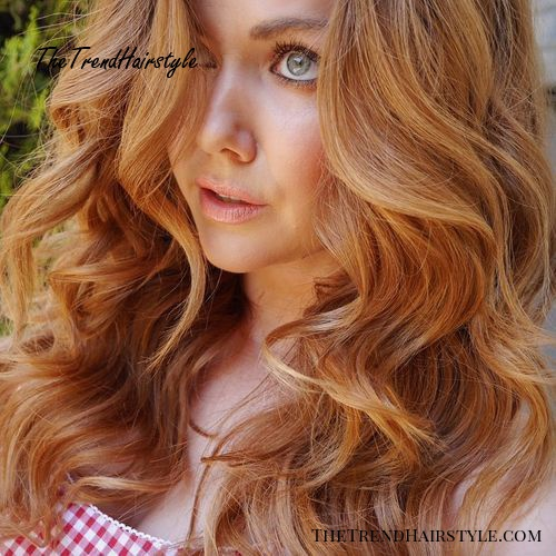 long layered curly copper blonde hairstyle