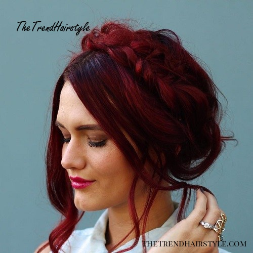 loose and messy burgundy milkmaid braid