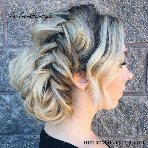 loose fishtailed updo with bangs