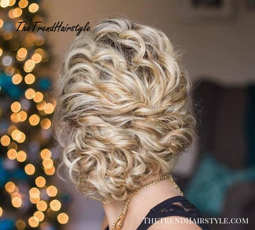 loose updo for curly hair