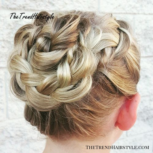 loosely braided blonde bun updo