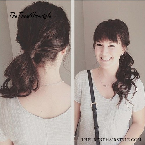 low wavy ponytail with bangs