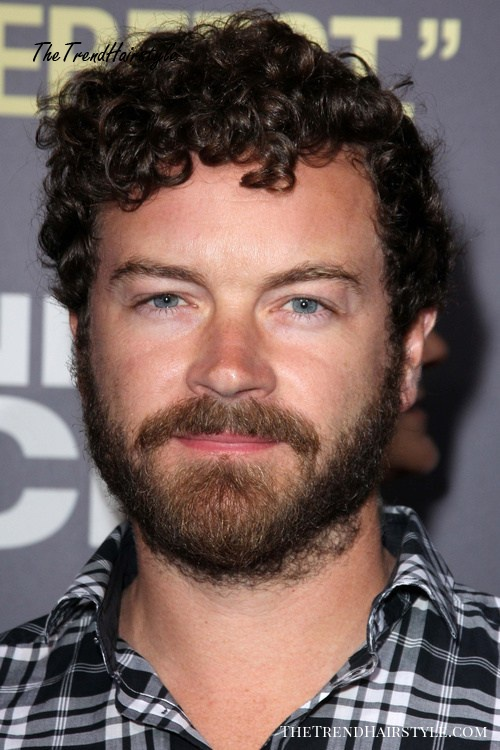 mens short curly hairstyle